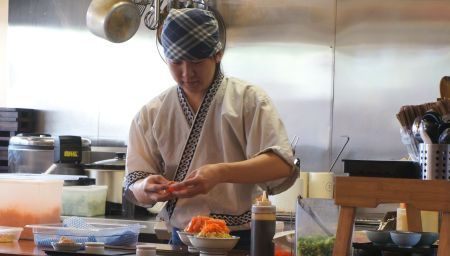 A Japanese chef cooking food. Posted on The Black Lion Journal