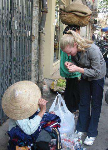 Caitlin threading a needle