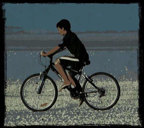 boy on bike - 80 Mile Beach