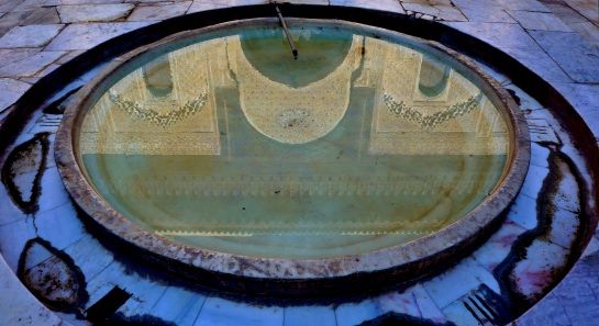 Fes - Medersa - reflection in courtyard fountain